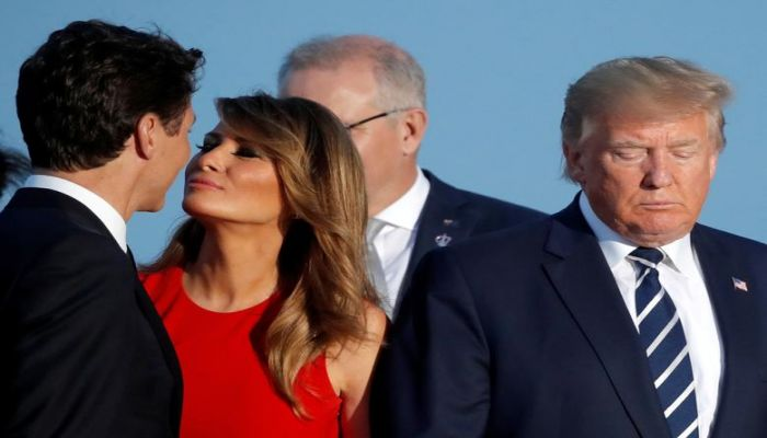 First lady Melania Trump kisses Canada's Prime Minister Justin Trudeau next to U.S. President Donald Trump during the family photo at the G7 summit in Biarritz, France, August 25. Photo: Collected