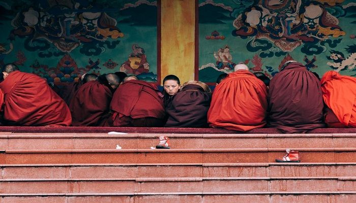 Sandra Morante's photograph in the Traveller category shows the moment a young Buddhist novice looked at the photographer during a ceremony at a temple in Larung Gar, in the Sichuan province of China.