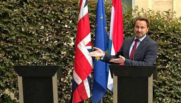 Luxembourg Prime Minister Xavier Bettel, gestures to an empty podium as he speaks to the press after meeting UK counterpart Boris Johnson, who cancelled his press appearance because he feared he would be drowned out by protesters. Photo: KILIAN FICHOU