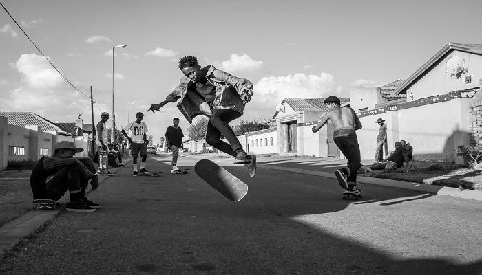 Karabo Mooki's photograph shows skateboarders on the street, in Soweto, South Africa.