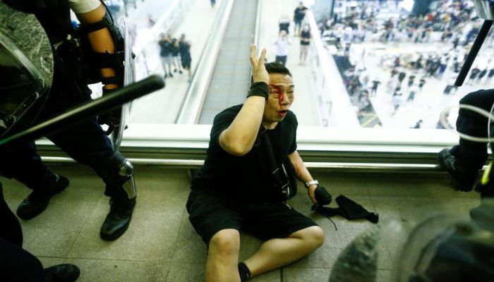 Police clash with anti-government protesters at the airport in Hong Kong, August 13, 2019. REUTERS