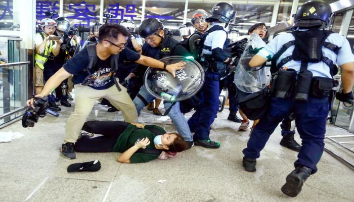Riot police disperse anti-extradition bill protesters during a mass demonstration at the Hong Kong international airport, in Hong Kong August 13, 2019. REUTERS