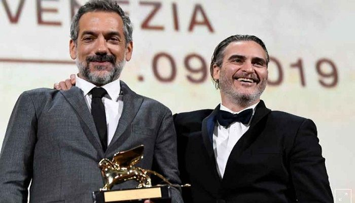 The 76th Venice Film Festival - Awards Ceremony - Venice, Italy, Sep 7, 2019 - Director Todd Phillips poses next to Joaquin Phoenix after winning the Golden Lion for Best Film. REUTERS