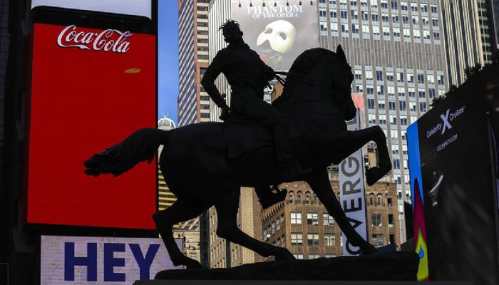 """A bronze sculpture, """"Rumors of War,"""" by artist Kehinde Wiley, appears in Times Square at an unveiling on Friday, Sept. 27, 2019, in New York. The work, depicting of a young African American in urban streetwear sitting astride a galloping horse, will be exhibited through December 1. Photo: AP"""