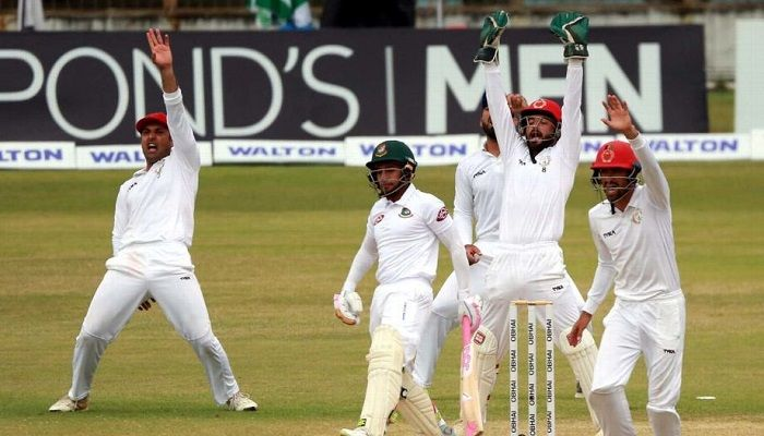 The Afghanistan players go up in appeal for Mushfiqur Rahim's wicket BCB