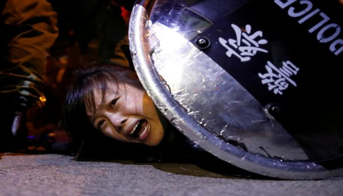 An anti-extradition bill protester is detained by riot police during a protest outside Mong Kok police station in Hong Kong, September 2, 2019. REUTERS