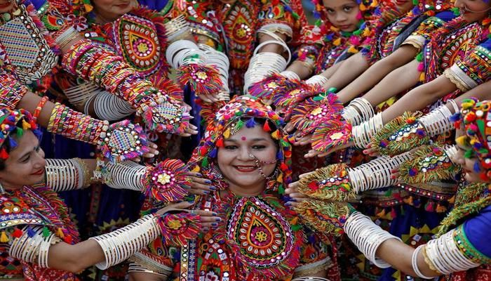 Participants in traditional attire pose for pictures during rehearsals for the Garba folk dance, in preparations for Navratri, a festival during which devotees worship the Hindu goddess Durga, in Ahmedabad, India, September 25, 2019. REUTERS