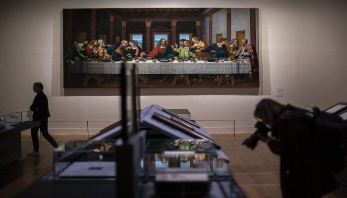 The Last Supper by Leonardo da Vinci displayed at the Louvre museum Sunday, Oct. 20, 2019 in Paris. A unique group of artworks is displayed at the Louvre museum in addition to its collection of paintings and drawings by the Italian master. The exhibition opens to the public on Oct.24, 2019. (AP Photo)