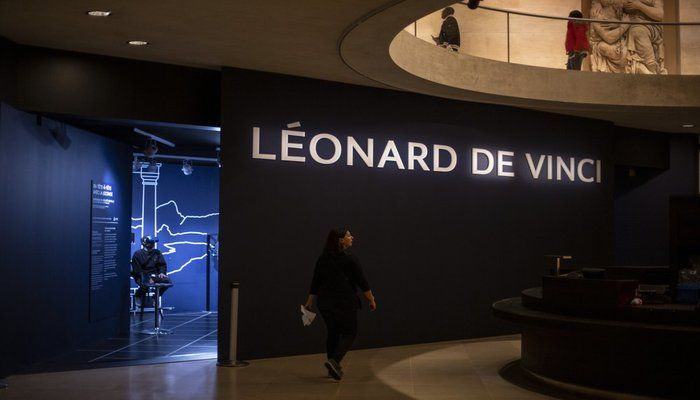 A journalist experiences the virtual reality performance during the visit of Leonardo da Vinci exhibition at the Louvre museum Sunday, Oct. 20, 2019, in Paris. A unique group of artworks is displayed at the Louvre museum in addition to its collection of paintings and drawings by the Italian master. The exhibition opens to the public on Oct.24, 2019. (AP Photo)