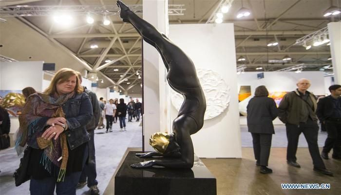 "People look at the sculpture ""Perseverance II"" during the 2019 Art Toronto in Toronto, Canada, on Oct. 26, 2019. Presenting works by over 100 galleries from across Canada and around the world, this annual three-day fair was held here from Friday to Sunday to draw tens of thousands of art collectors, professionals, and enthusiasts. Photo: Xinhua"