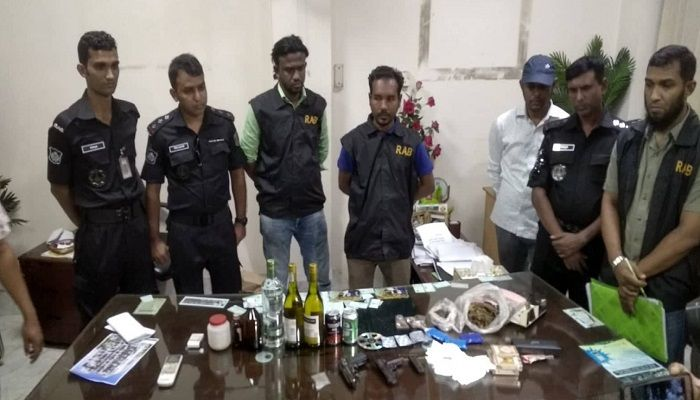 Members of Rapid Action Battalion at the office of ward councillor Manju in Tikatuli area of Dhaka following a raid on Thursday, October 31, 2019. Photo: Collected