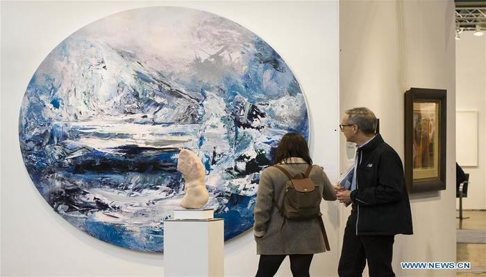 "People view the artwork ""Magnetic North"" during the 2019 Art Toronto in Toronto, Canada, on Oct. 26, 2019. Presenting works by over 100 galleries from across Canada and around the world, this annual three-day fair was held here from Friday to Sunday to draw tens of thousands of art collectors, professionals, and enthusiasts. Photo: Xinhua"