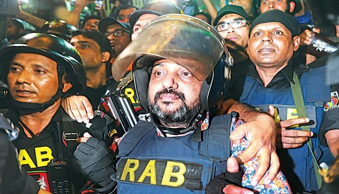 Expelled president of Dhaka City (South) Jubo League Ismail Hossain Samrat being taken to his Kakrail office in the capital by Rab during a raid there. Samrat was arrested in Cumilla yesterday. Photo: Collected