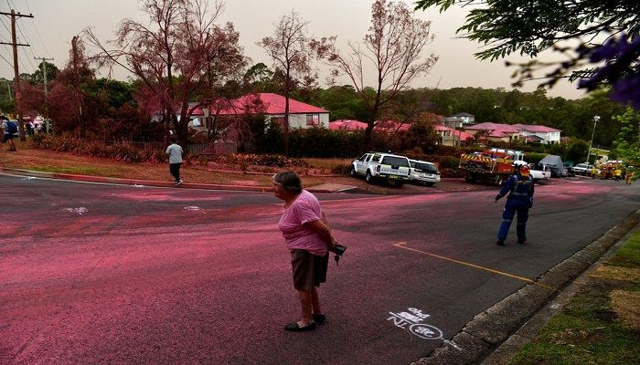Bright pink fire-retardant was dropped on to homes during firefighting efforts