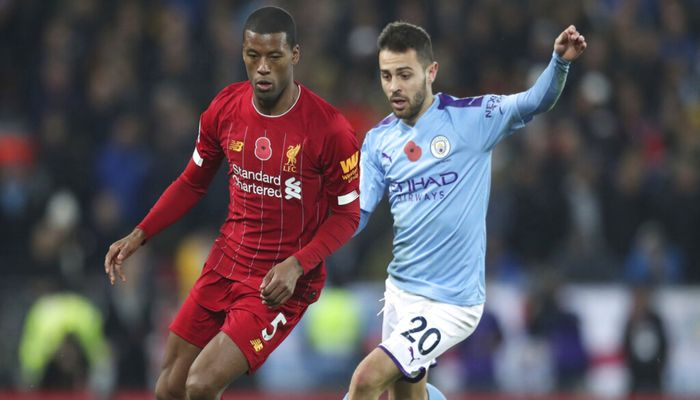Manchester City's Bernardo Silva, right, challenges for the ball with Liverpool's Georginio Wijnaldum during the English Premier League soccer match between Liverpool and Manchester City at Anfield stadium in Liverpool, England, Sunday, Nov. 10, 2019. Photo: AP