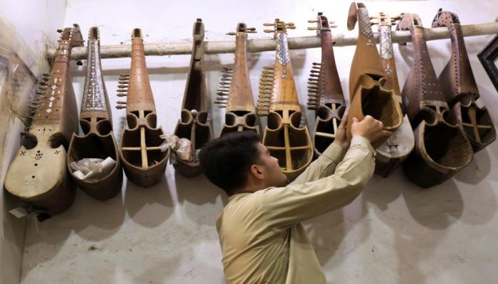 A craftsman arranges unfinished Rabab, traditional music instruments, at a workshop in Peshawar, Pakistan August 20, 2019.  Photo: REUTERS