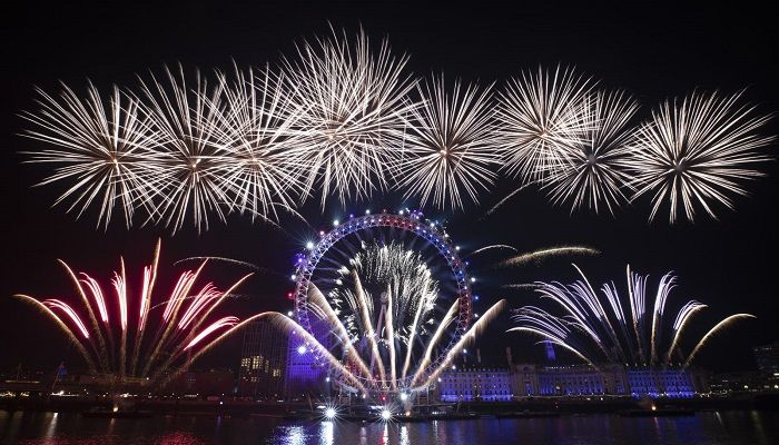 Fireworks explode over the London Eye by the River Thames in London. Photo: AP