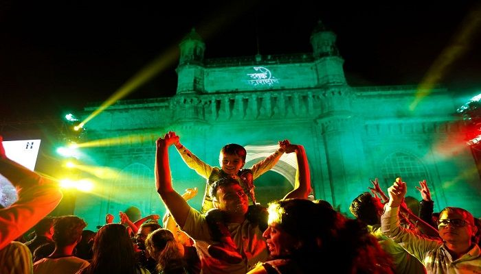 People celebrate New Year's Eve in front of the Gateway of India in Mumbai. Photo: AP