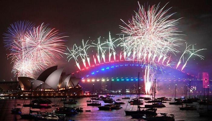 New Year's Eve fireworks erupt over Sydney's iconic Harbor Bridge and Opera House. Photo: AFP