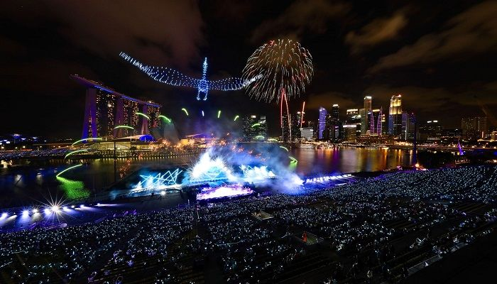 Drones form the shape of a crane in the sky as fireworks erupt at Singapore's Marina Bay. Photo: Getty Images