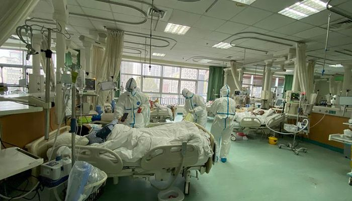 Medical staff at Wuhan Central Hospital attending patients. Photo: Reuters