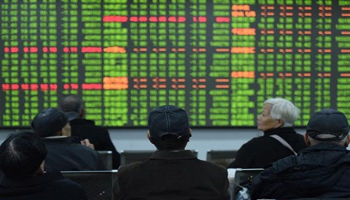Investors sit in front of a board showing stock information at a brokerage house on the first day of trade in China since the Lunar New Year, in Hangzhou, Zhejiang province, China February 3, 2020. Reuters File Photo