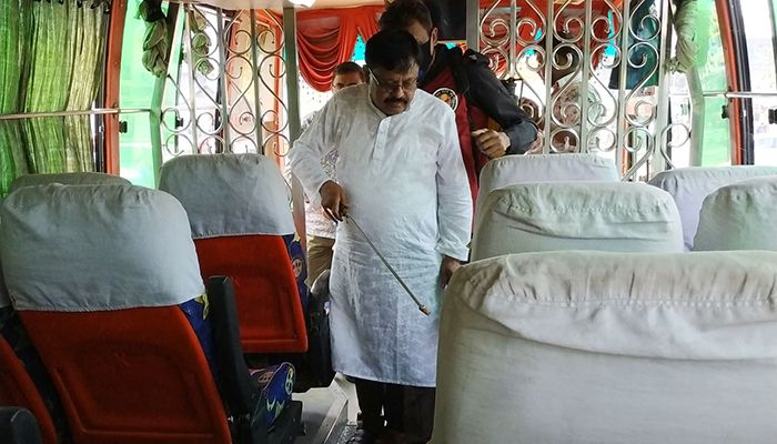 The DNCC has taken various programs to prevent coronavirus. As part of the program, disinfectants were sprayed inside the bus before leaving the bus from Mohakhali bus terminal yesterday. Photo: Star Mail