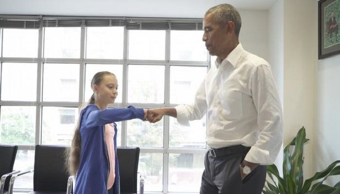 Fist bump:  Commonly used in sports, the greeting was also popularized by former US President Obama, shown here with Swedish climate activist Greta Thunberg. Beyond the coolness factor, the fist bump transmits significantly fewer germs than shaking hands — about 90% less according to one study.