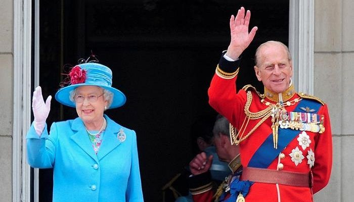 Wave:  Queen Elizabeth and Prince Philip wave here from the balcony of Buckingham Palace. The original gesture derived from a 18th-century tradition of knights saluting each other after removing the guard of their helmets to reveal their identity and show that they were coming in peace. Waving can, however, be seen as offensive in some countries.