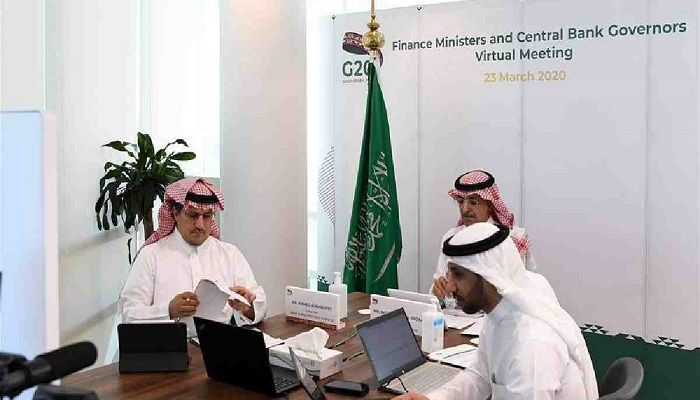 Governor of Saudi Arabian Monetary Authority Ahmed al-Kholifey (L) and Saudi Finance Minister Mohammed al-Jadaan (Rear) attend the G20 Finance Ministers and Central Bank Governors Virtual Meeting in Riyadh, Saudi Arabia. Photo: Collected from Xinhua