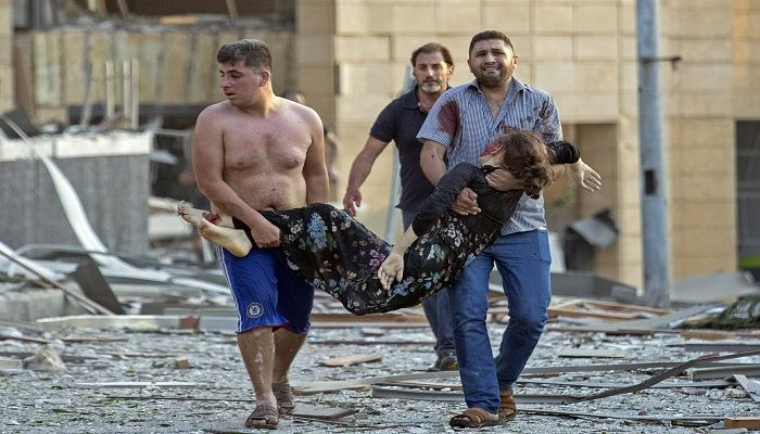 A wounded woman is evacuated after the massive explosion. Photo: Collected from AP
