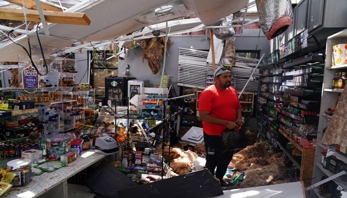 Ahmed Nawaz surveys the damage to his store after Hurricane Laura whipped through the US city of Lake Charles in Louisiana. At least six people were killed, as winds of up to 150mph (240km/h) caused major disruption, leaving more than half a million homes without power.