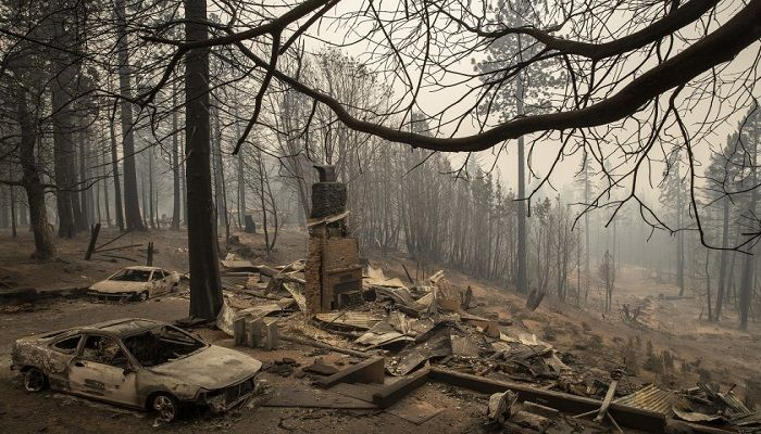 The ruins of a home in Brush Creek in Butte County smolder Thursday. Photo: Collected