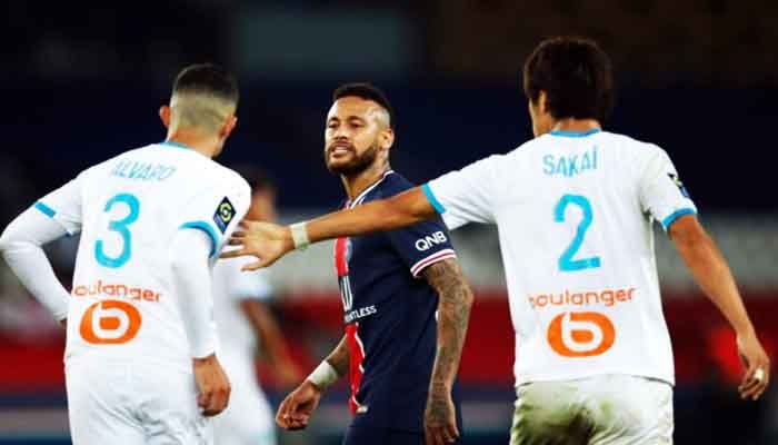 Paris St Germain's Neymar clashes with Olympique de Marseille's Alvaro Gonzalez during their Ligue 1 match at the Parc des Princes in Paris on September 13. Photo: Collected from Reuters
