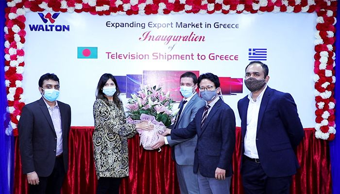 Photo: Walton Hi-Tech Industries Limited Director Raisa Sigma Hima is presenting a flower bouquet to Greek business partner Georgios Tziallas at the inauguration of television shipment to Greece at Walton Corporate Office board room in the capital recently.