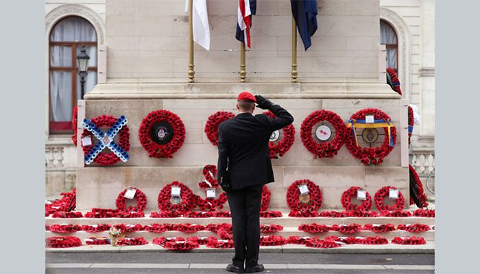 A member of the armed services salutes at the Cenotaph in London, on Armistice Day. Around the UK, people observed the annual two minutes' silence to mark the day in 1918 when World War One ended.
