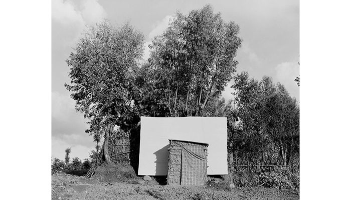 Athanasia's toilet, constructed under a eucalyptus tree, was built for her by the community. It has a view of Gitwa below, sandy paths and steeply terraced vegetable gardens. Photo: Elena Heatherwick/WATERAID