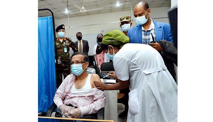 Law Minister Anisul Huq Receives COVID-19 Vaccine