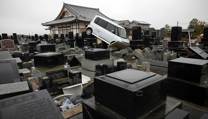 A damaged car is seen in a cemetery at an area devastated by the March 11 earthquake and tsunami, in Watari, Miyagi prefecture, April 22. Photo: Collected from Reuters