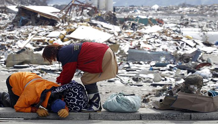 Survivors react after collecting their belongings at their destroyed house in a village hit by an earthquake and tsunami in Otsuchi, March 17. Photo: Collected from Reuters