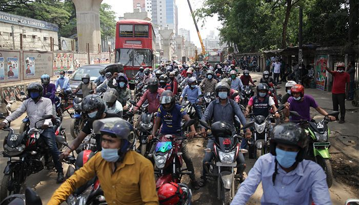 Motorcyclists protest for lifting up a ban on ride-sharing on motorcycles after the resumption of public transport in the City Corporation area. Photo: Star Mail