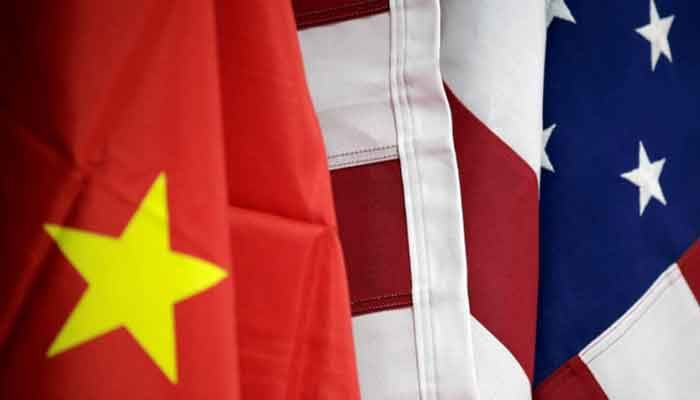 Flags of US and China are displayed at American International Chamber of Commerce (AICC)'s booth during China International Fair for Trade in Services in Beijing, China, May 28, 2019 || Photo: Reuters