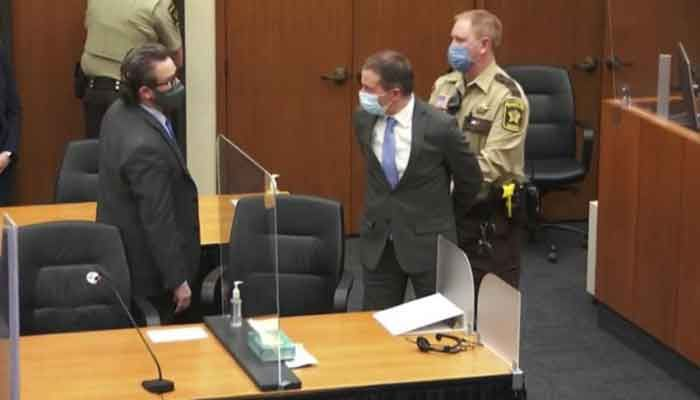 In this April 20, 2021 file image from video, former Minneapolis police Officer Derek Chauvin, center, is taken into custody as his attorney, Eric Nelson, left, looks on, after the verdicts were read at Chauvin's trial for the 2020 death of George Floyd, at the Hennepin County Courthouse in Minneapolis, Minnesota. Photo: AP