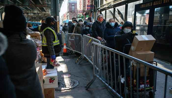 A line for food distribution in Brooklyn on Nov. 23, 2020, the Monday before Thanksgiving. Food banks have seen a sharp rise in demand this year. Photo: The New York Times