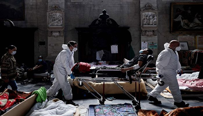 (Brussels, Belgium) Nurses evacuate a migrant on hunger strike from Saint-Jean-Baptiste-au-Beguinage church in Brussels. Several hundred migrants, among them 220 people on hunger strike for 11 days, have occupied a church in Brussels since 31 January to call for more initiatives to enable them to work. || Photograph: Kenzo Tribouillard/AFP/Getty Images