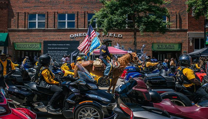 (Tulsa, Oklahoma) Members of the Buffalo Soldiers bike club participate in the centennial Black Wall St heritage parade in the Greenwood district of Tulsa, during the commemorations of the 100th anniversary of the Tulsa race massacre. || Photograph: Brandon Bell/Getty Images