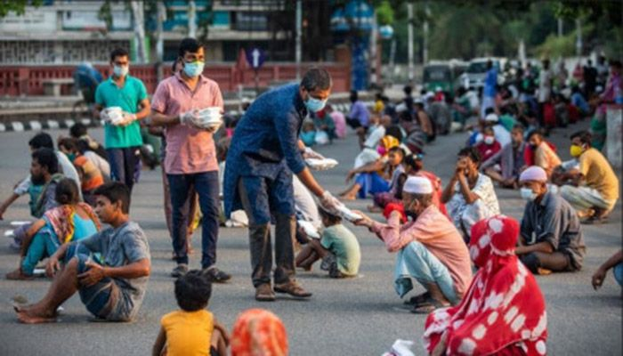 Locally-led committees in Dhaka help provide food to the less fortunate amid the pandemic. Photo: Collected