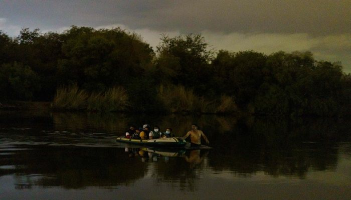 (Roma, Texas, US) A smuggler pulls an inflatable raft across the Rio Grande and into the US from Mexico. Republican lawmakers have criticized President Joe Biden for reversing Trump programmes, including his 'remain in Mexico' policy, which had forced thousands of asylum seekers from Central America to stay south of the US border until their claims were processed. (Photograph: AFP)