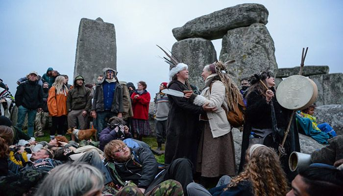 (Amesbury, England) A large number of people enter the closed site at Stonehenge after English Heritage, which manages the site, canceled the planned summer solstice celebrations.    Photograph: Finnbarr Webster