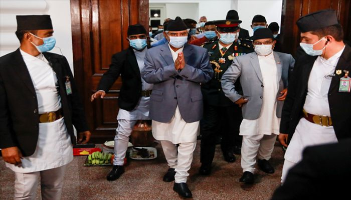 Newly appointed Prime Minister Sher Bahadur Deuba, wearing a face mask, walks after formally assuming office at Singha Durbar office complex that houses the Prime Minister's office and other ministries, in Kathmandu, Nepal July 13, 2021. || Reuters Photo: Collected